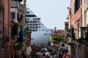 A cruise ship overshadows a Venetian canal